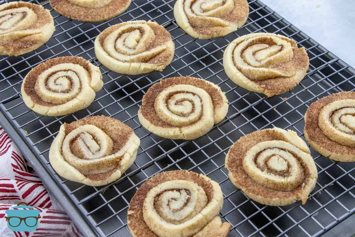 fully baked Cinnamon Roll-style cookies cooling on a baking rack.