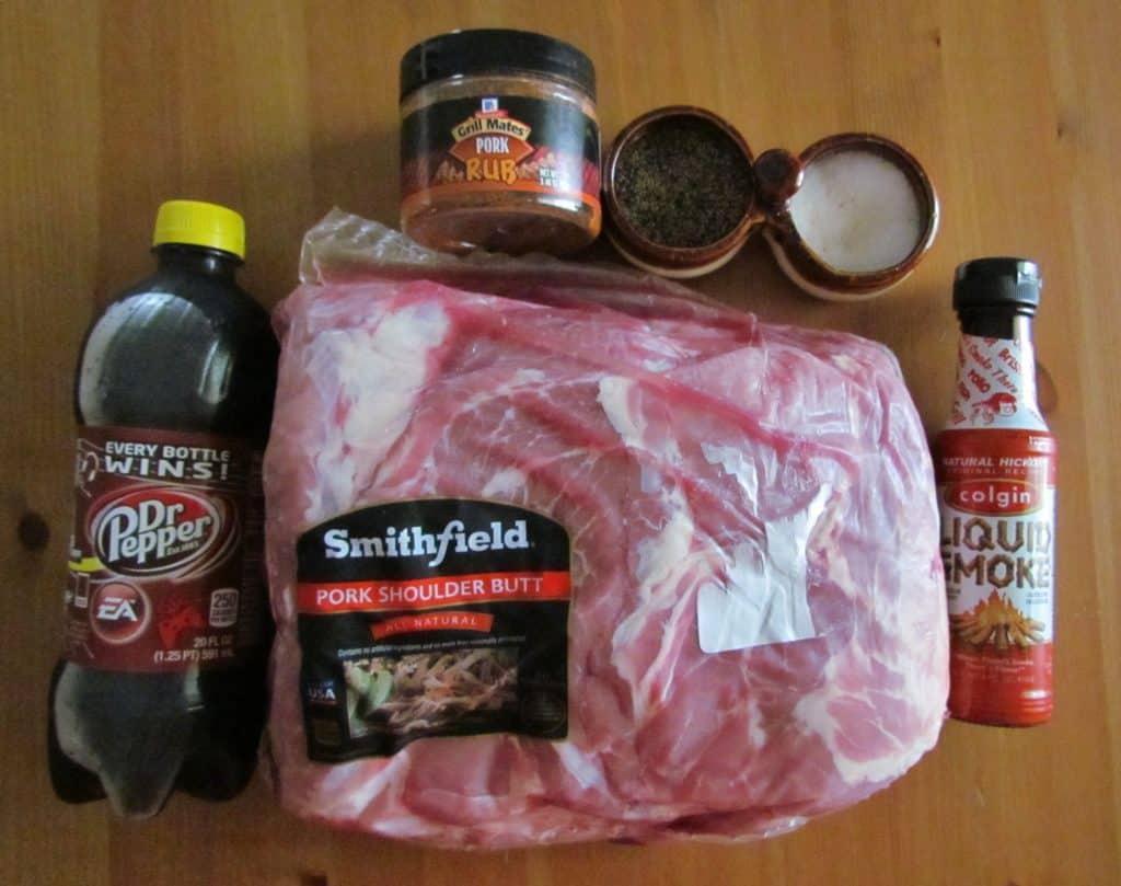 pork shoulder roast, Dr. Pepper, hickory liquid smoke, pork rub seasoning, BBQ sauce