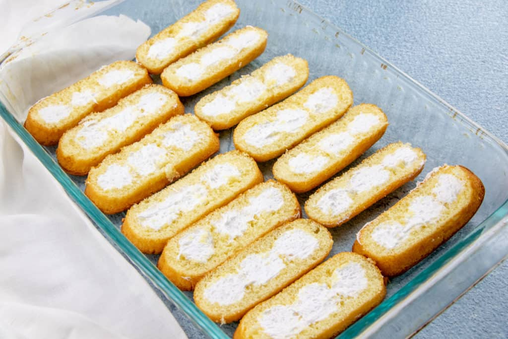 cream side up sliced Twinkies in a 9X13 baking pan