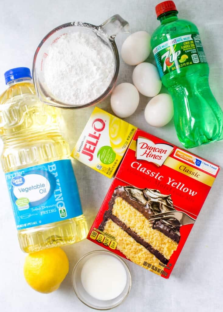 yellow cake mix, lemon instant pudding, 7Up soda, eggs, oil, lemon, powdered sugar
