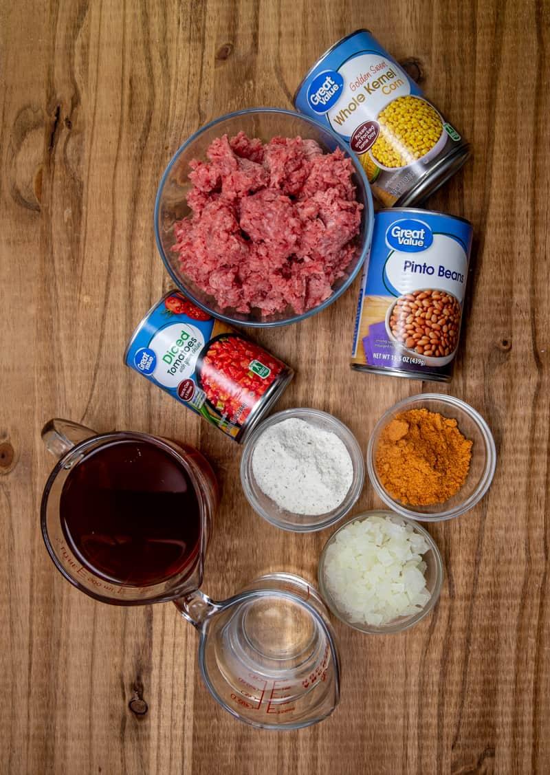 ground beef, taco seasoning, ranch seasoning, beef broth, pinto beans, corn, rotel, onion