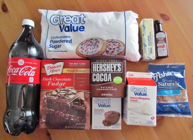 chocolate cake mix, Coca Cola, unsweetened cocoa, heavy whipping cream, instant chocolate pudding, powdered sugar, butter, vanilla extract
