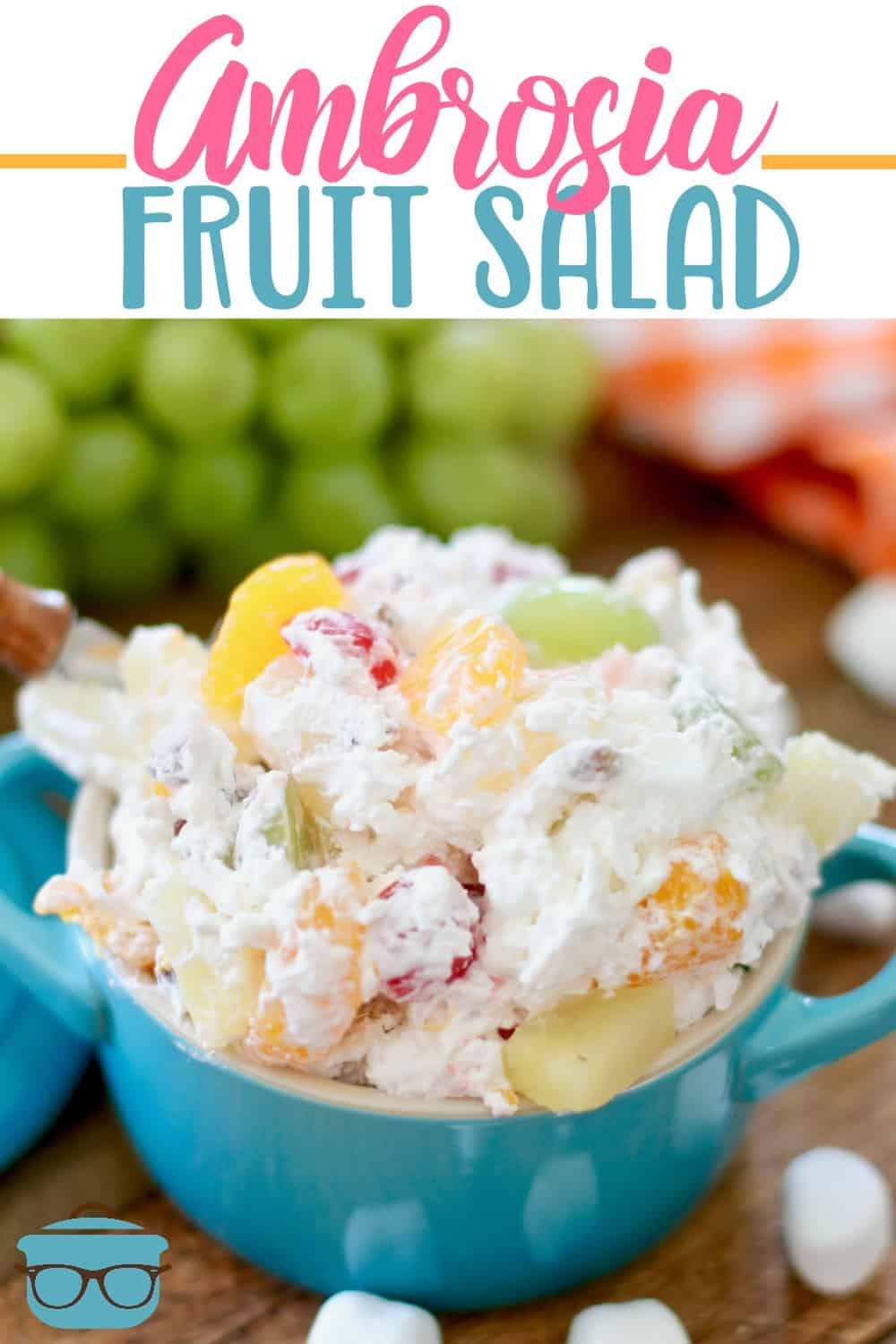 Southern Ambrosia Fruit Salad is a must-have at any gathering. Whipped topping, pineapple, grapes, mandarin oranges, maraschino cherries and coconut flakes! #fruitsalad #ambrosia