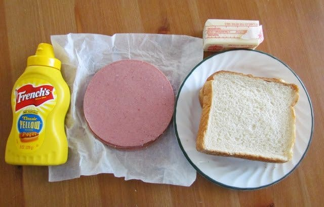 sliced bologna, mustard, soft white bread, butter