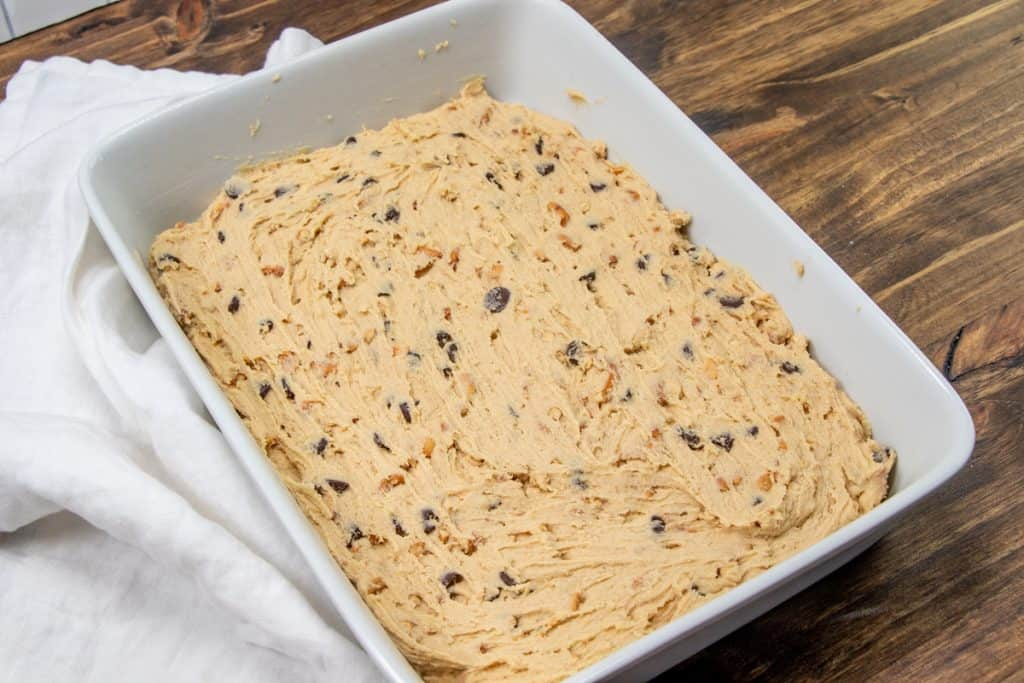 peanut butter chocolate bar batter spread evenly into a baking dish