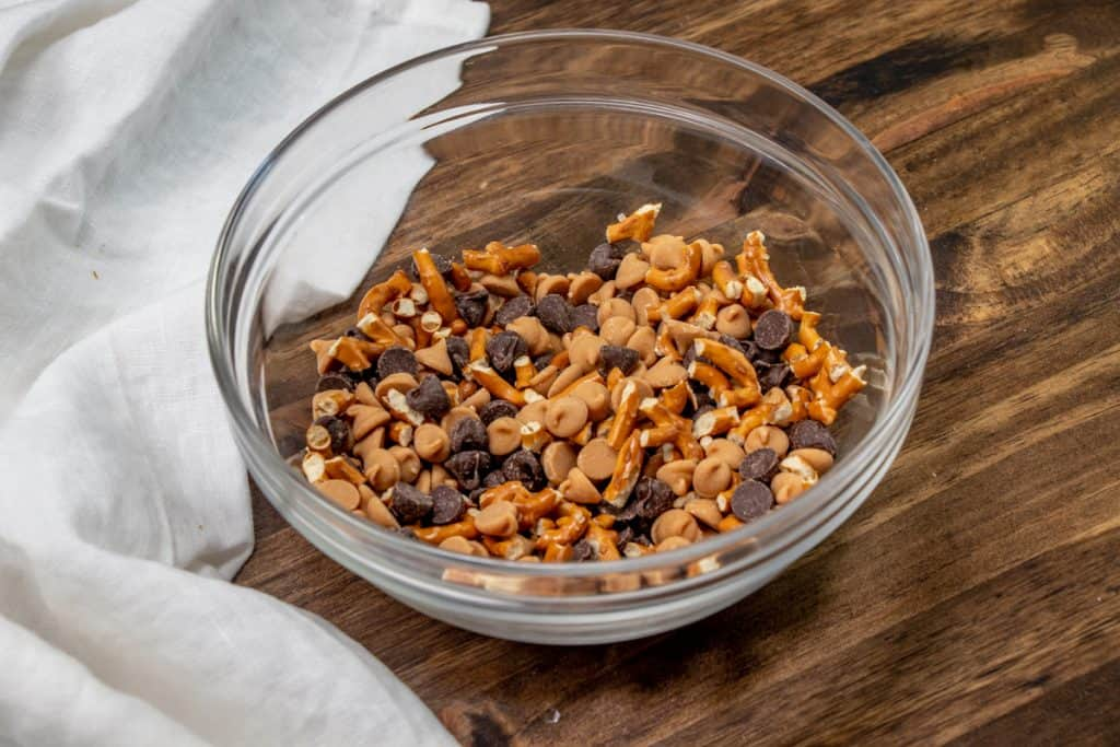 pretzels, chocolate chips and peanut butter chips mixed together in a bowl