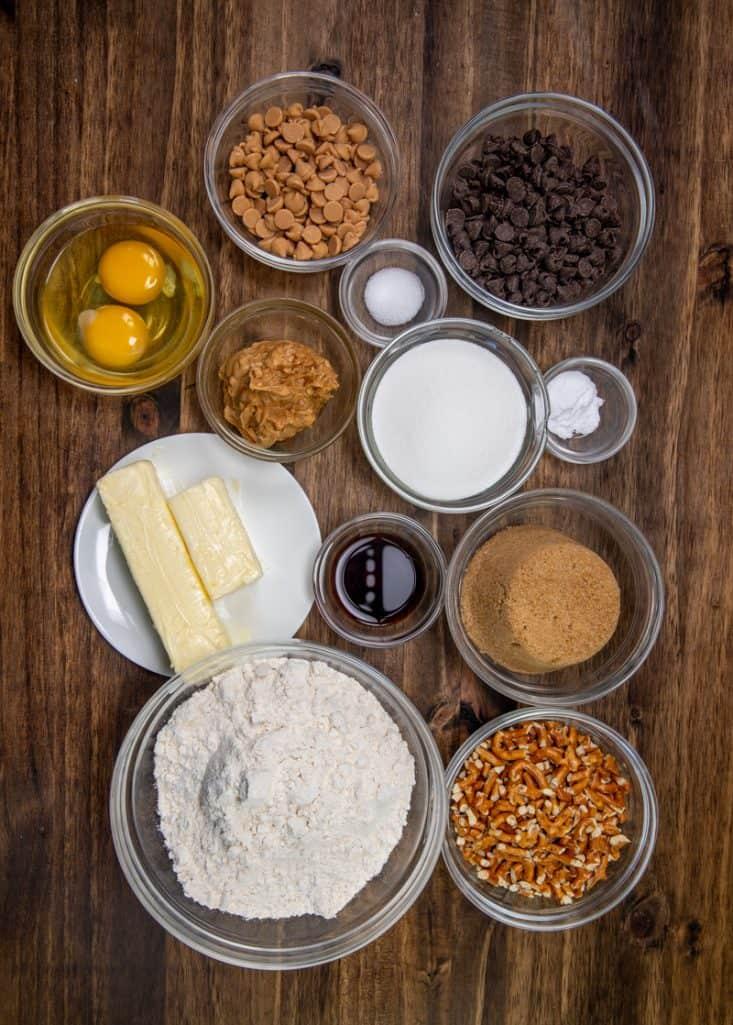 all-purpose flour, baking soda, salt, unsalted butter, light brown sugar, sugar, eggs, chunky peanut butter, vanilla extract, semi-sweet chocolate chips, chopped pretzels, peanut butter chips