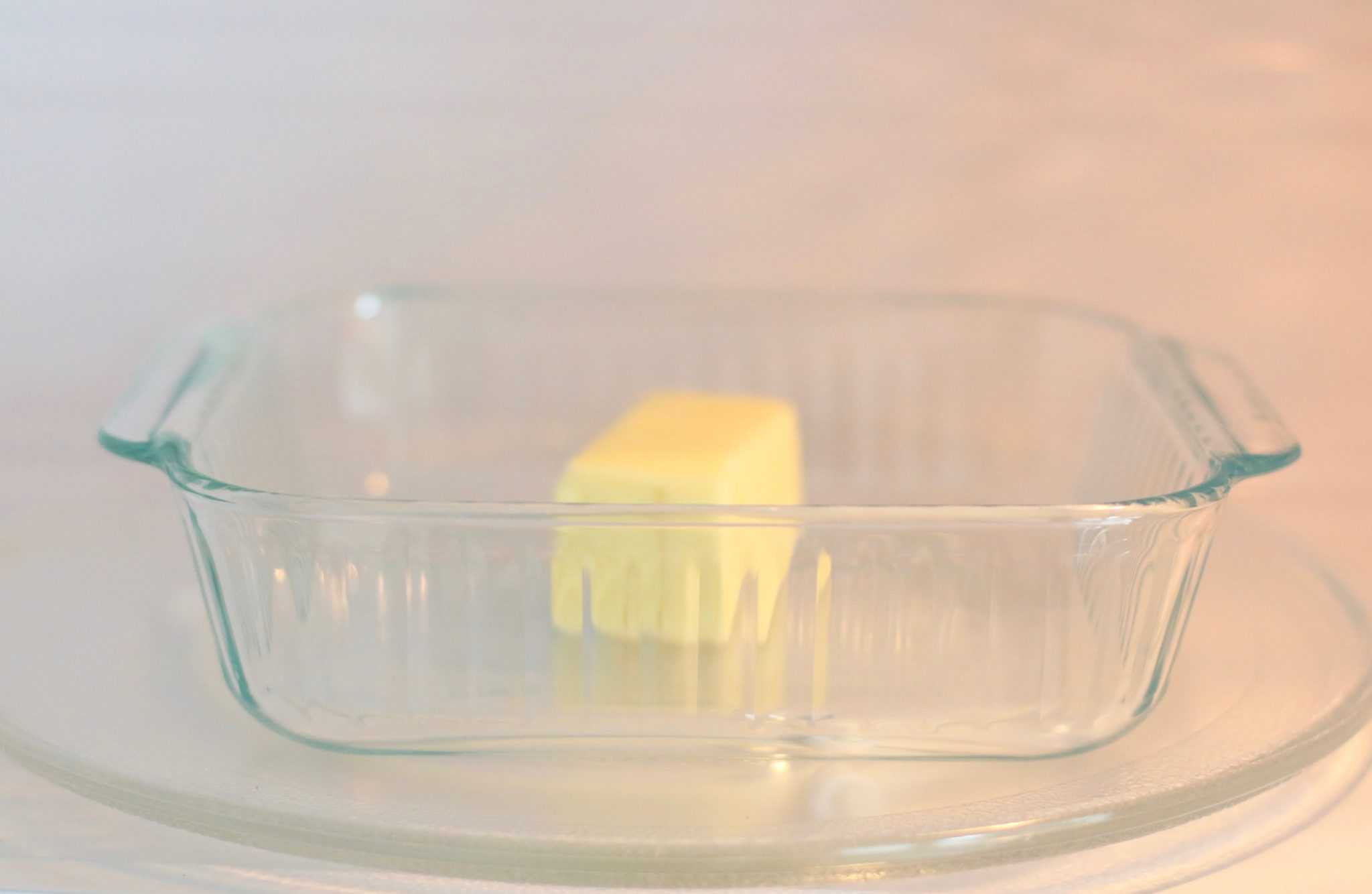 glass Pyrex dish, melting salted butter in microwave.