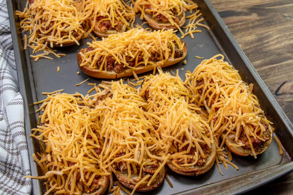 shredded cheddar cheese on top of ground beef mixture.