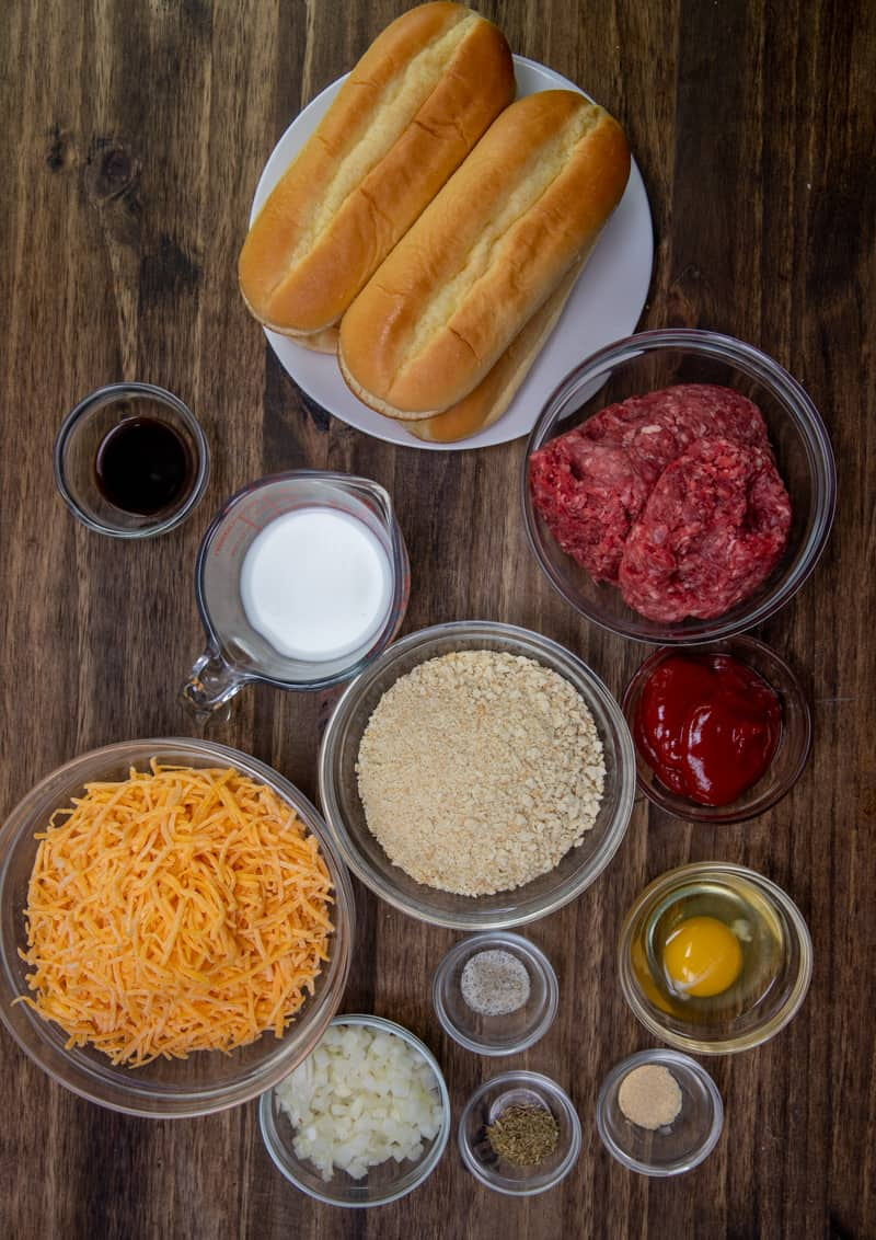 6-inch sub rolls, lean ground beef, crushed saltine crackers, egg, diced onion, milk, ketchup, Worcestershire sauce, dried thyme, garlic powder, shredded cheddar cheese, salt and pepper.