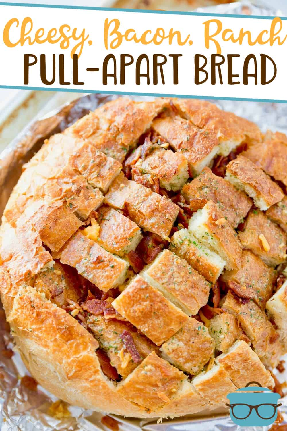 Cheesy Bacon Ranch Pull-Apart Bread is filled with melted cheese, bacon and ranch seasoning. This is everyone's favorite snack!