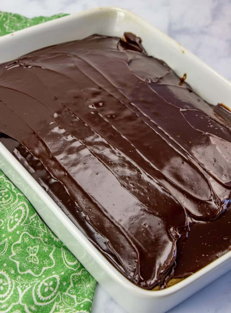 hot fudge sauce spread onto cooled, prepared cake
