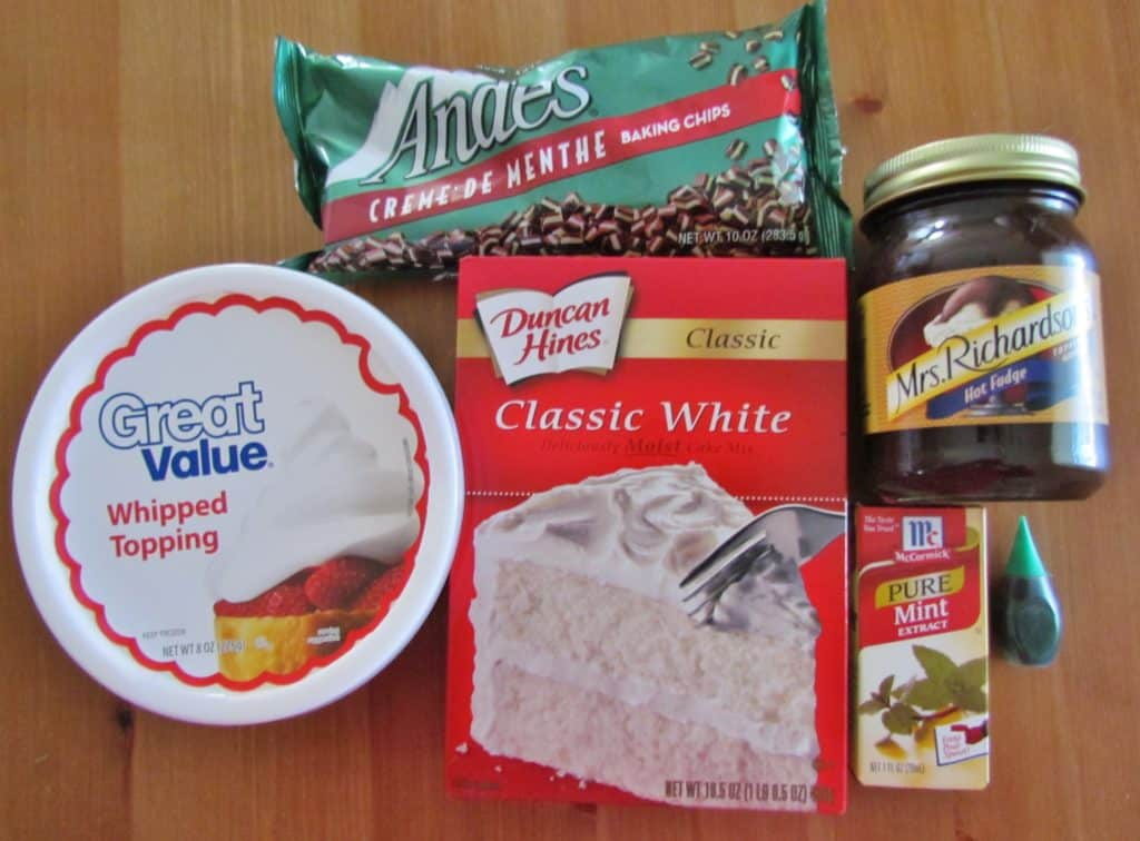 boxed white cake mix, hot fudge sundae sauce, mint extract, Andes mint chocolates, whipped topping, green food coloring