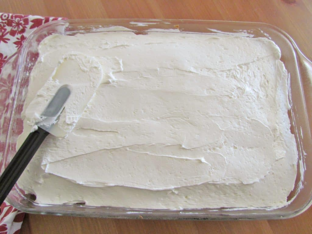 sweetened cream cheese mixture spread onto cooled, baked white cake