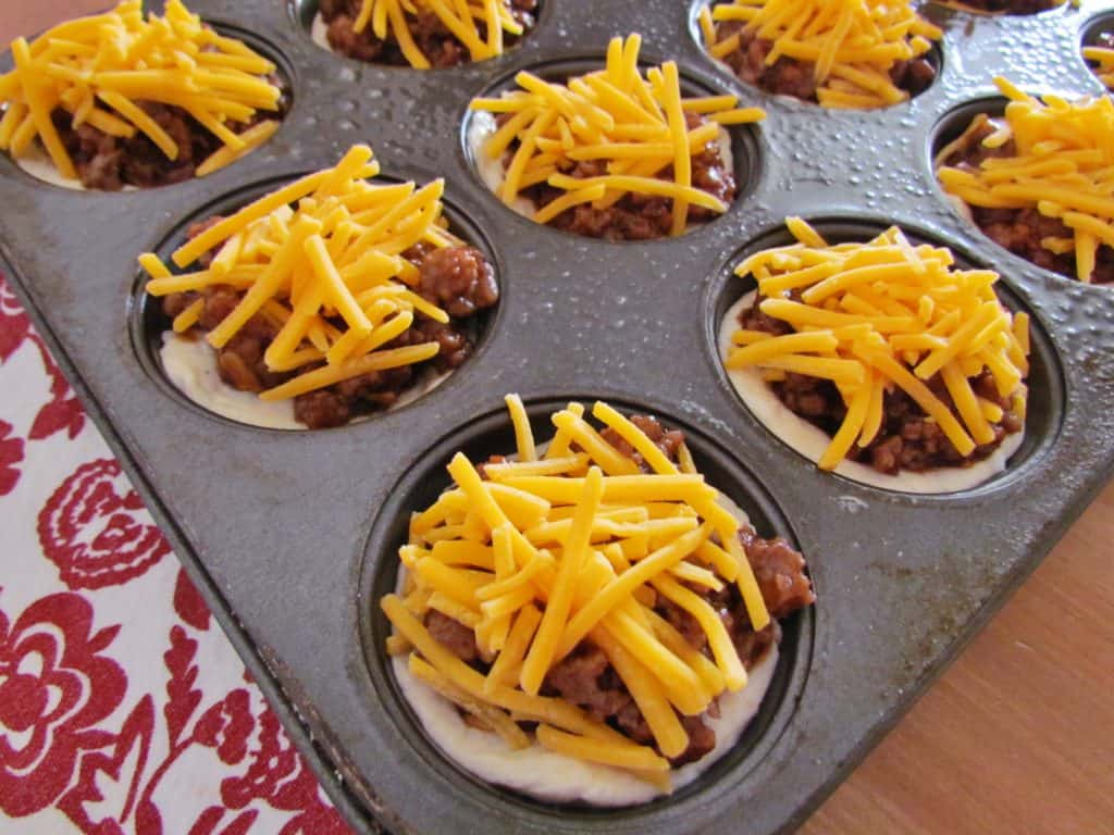 Barbecue Beef Biscuit Cups topped with shredded cheese