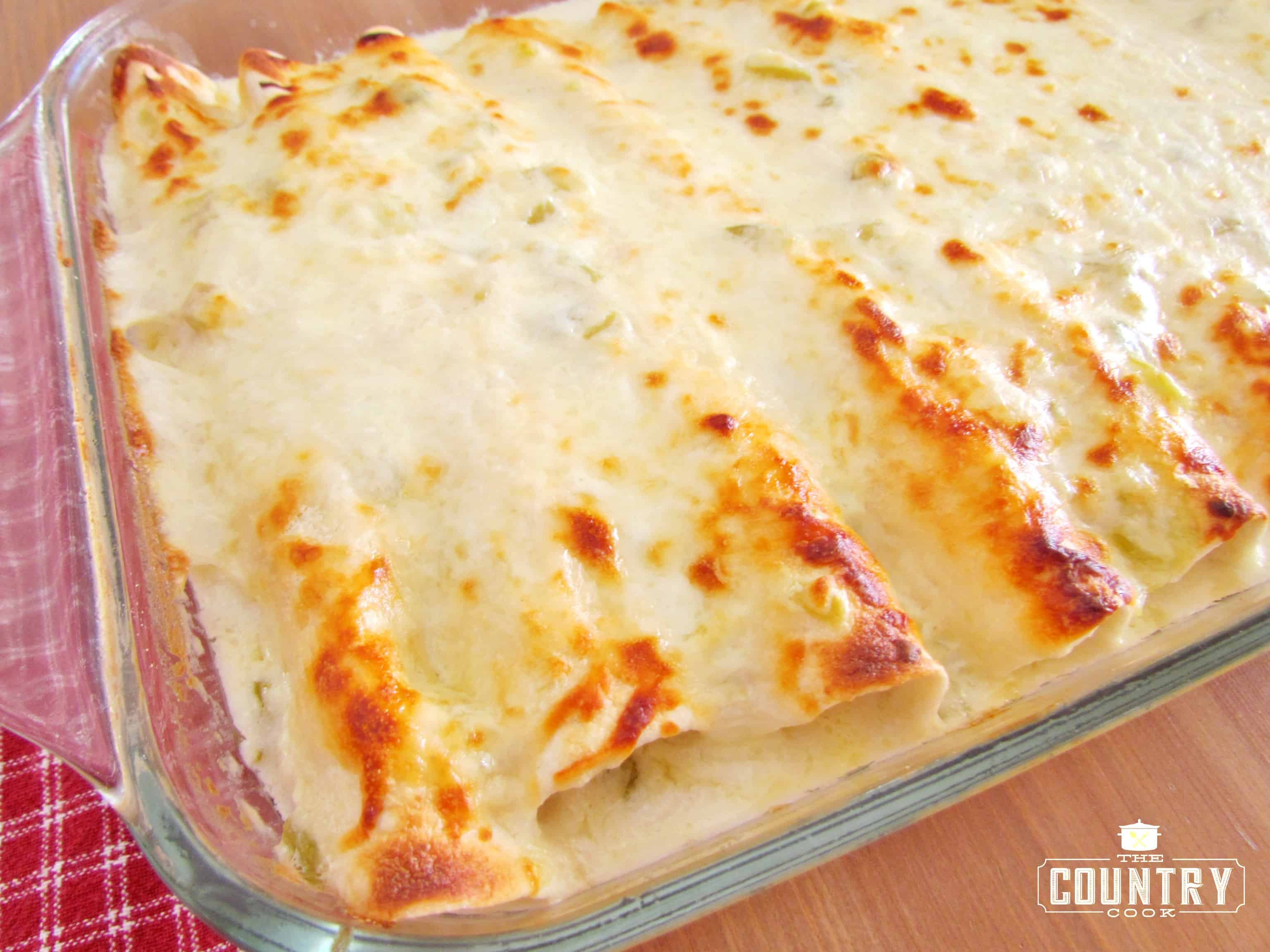 recipe: chicken enchiladas with cream of chicken soup and enchilada sauce [11]