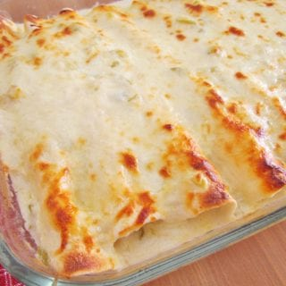 Creamy Chicken Enchiladas with white sauce