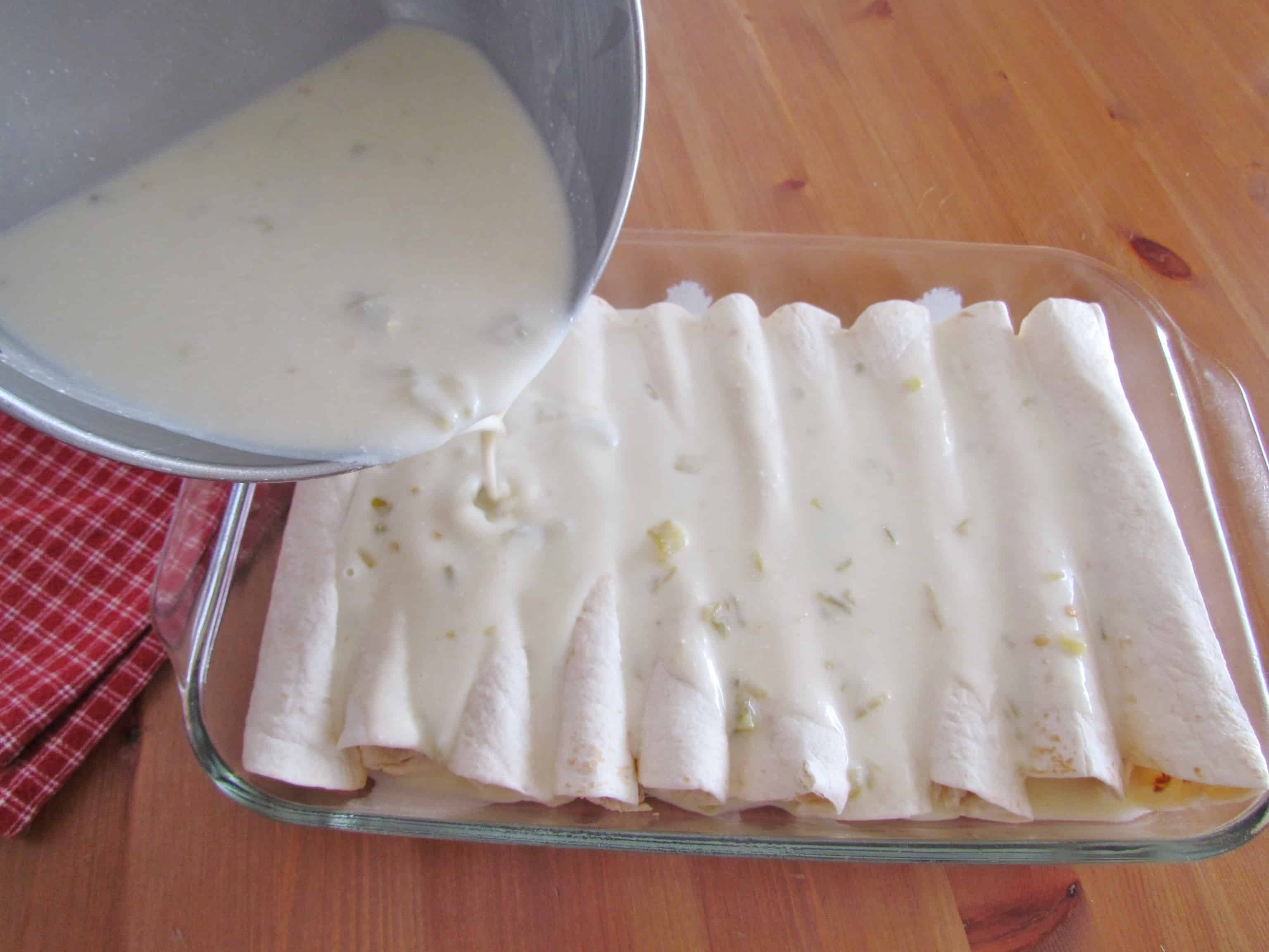 Creamy Chicken Enchiladas with White Sauce - The Country Cook