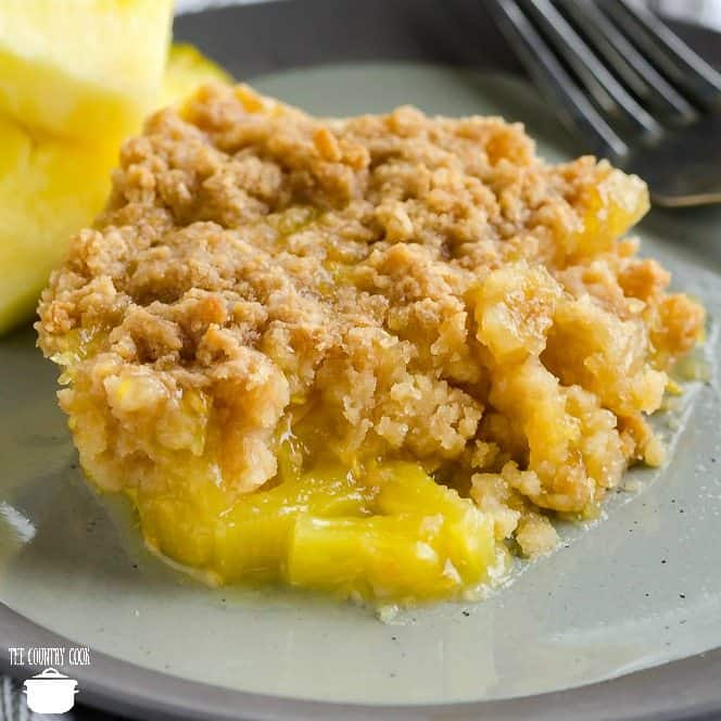 Warm Southern Pineapple Casserole with ritz crackers and cheddar cheese