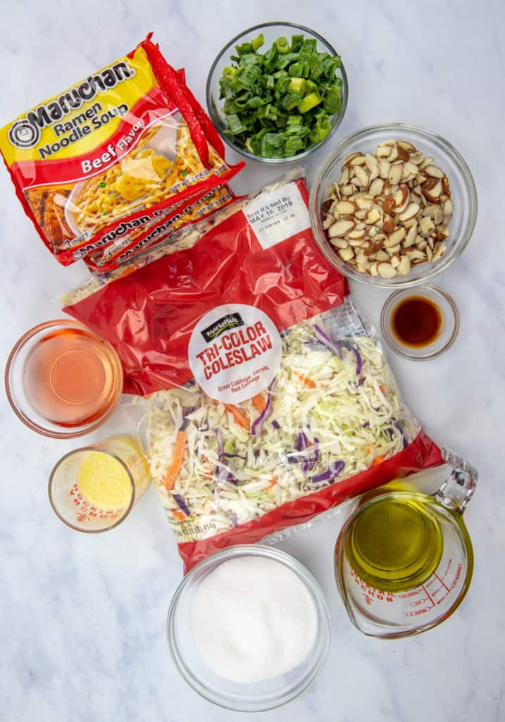 bagged cole slaw mix, green onions, beef flavored Ramen noodles, sliced almonds, butter, sugar, olive oil, Worcestershire sauce, red wine vinegar