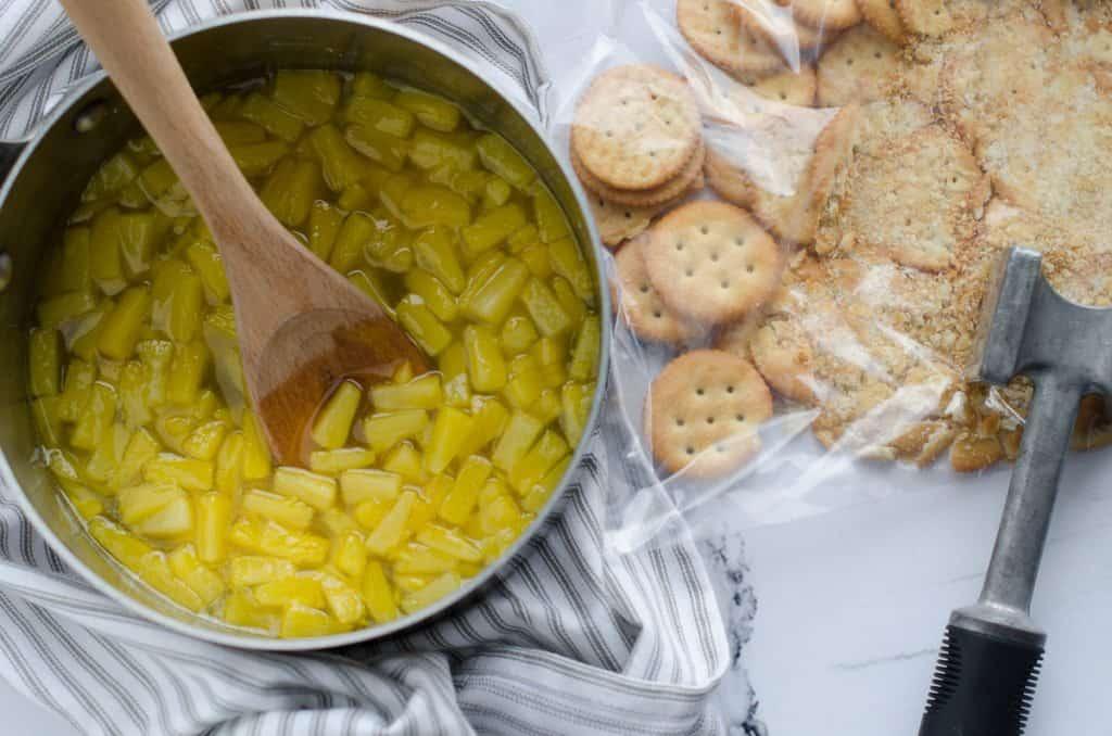 pineapple tidbits in sauce pan with pineapple gelatin