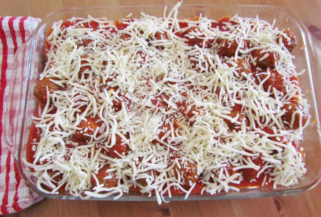 shredded mozarella cheese sprinkled on top of meatball sub casserole