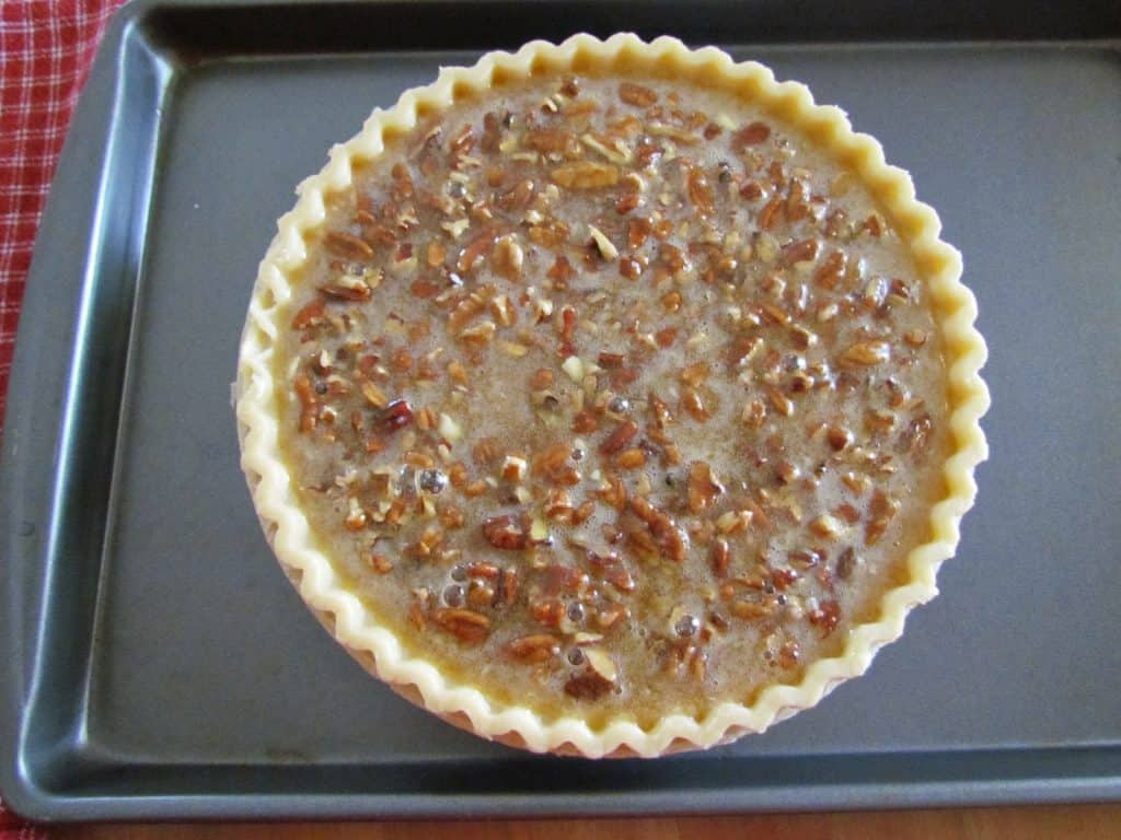 uncooked pecan pie on a baking sheet