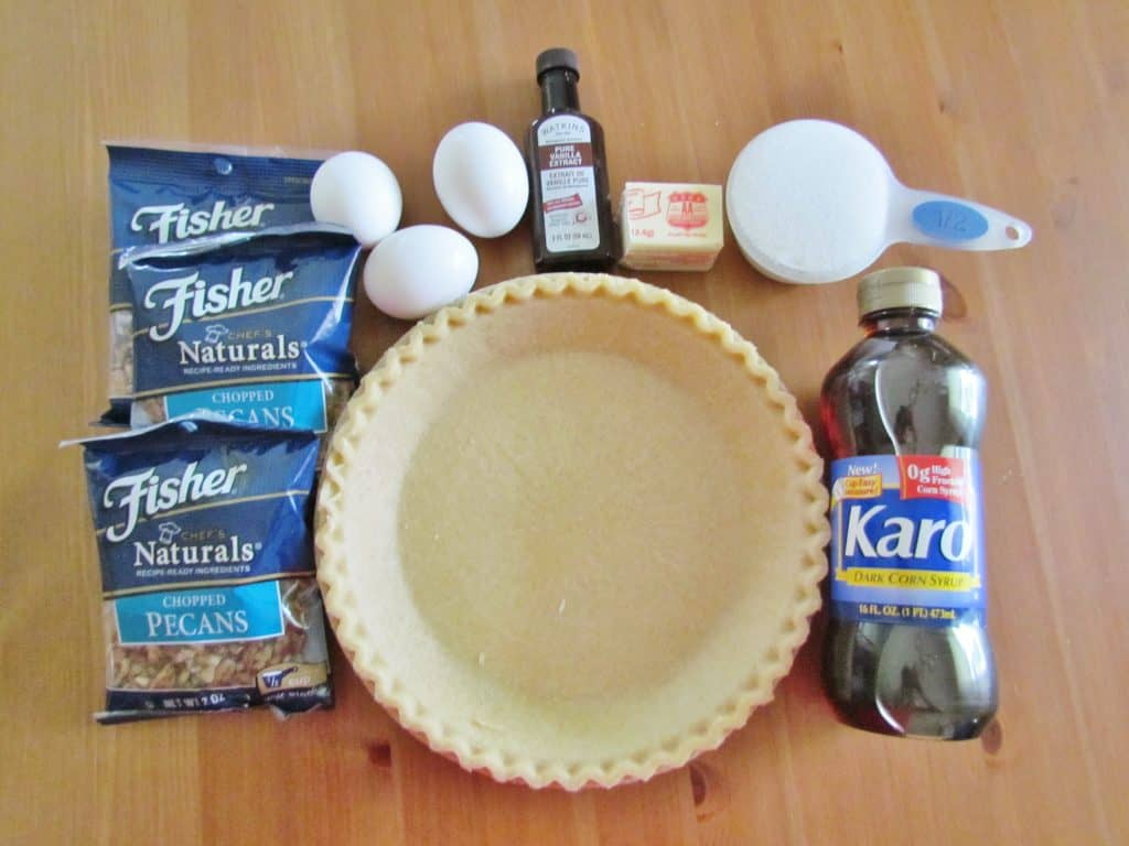 frozen pie crust, chopped pecans, eggs, sugar, salted butter, dark corn syrup, cinnamon, vanilla extract