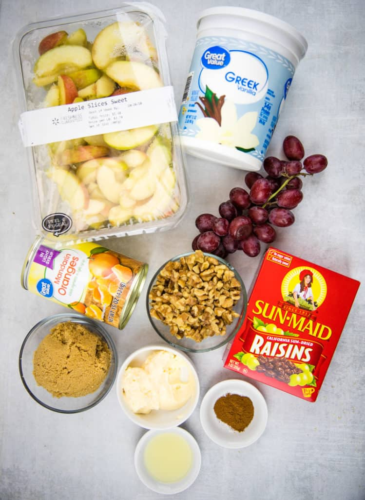 Greek vanilla yogurt, brown sugar, mayonnaise, ground cinnamon, apples, seedless grapes, mandarin oranges, walnuts, raisins