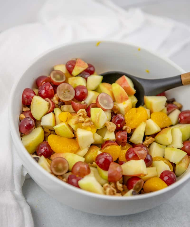 sliced fruit salad ingredients in a large bowl