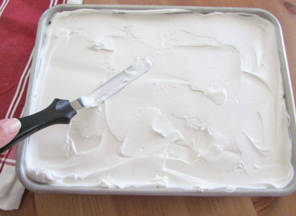 spread whipped topping (Cool Whip) on top of cooled cake