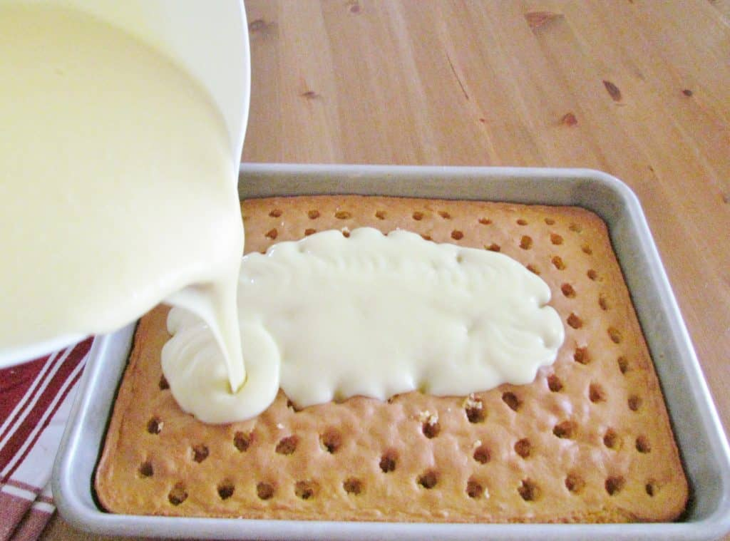 pour liquid pudding into holes in cake