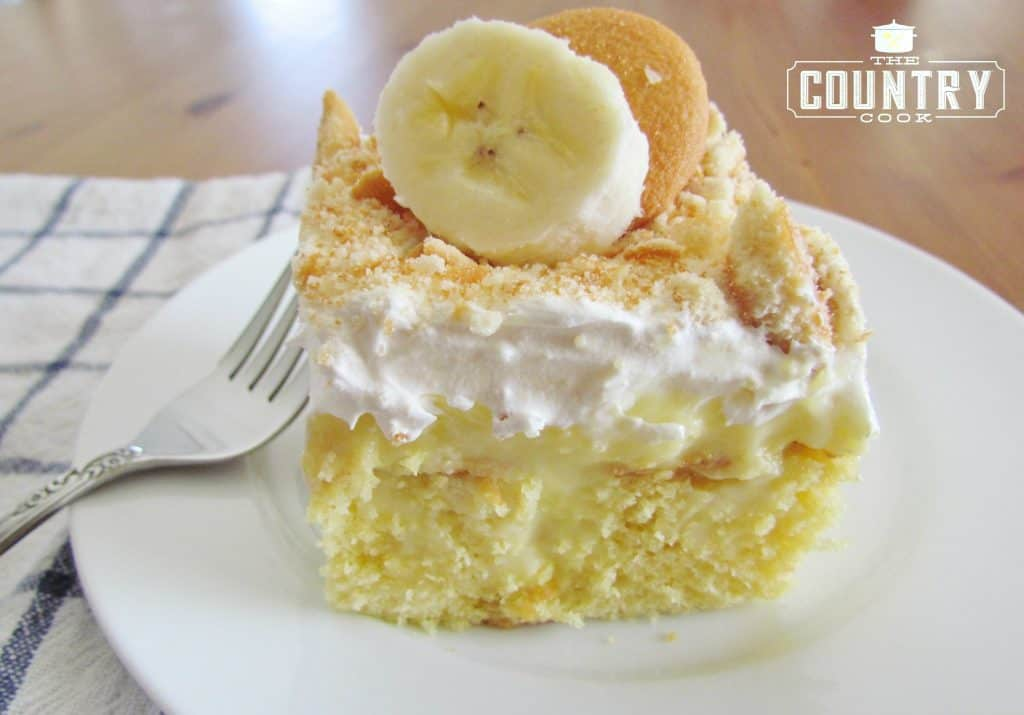 Banana Pudding Poke Cake recipe from The Country Cook, with sliced banana and Nilla wafer