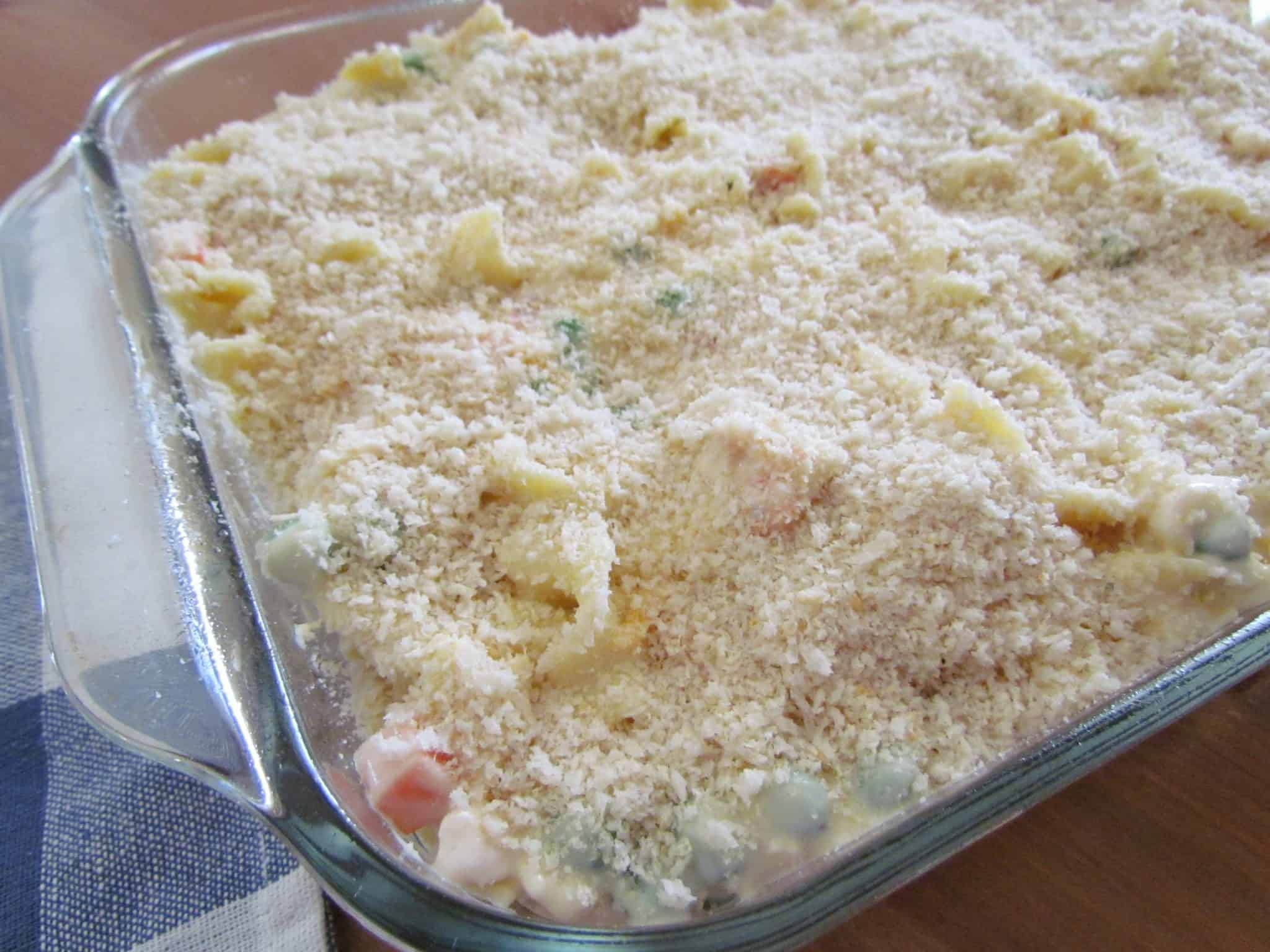 panko bread crumbs sprinkled on top of chicken noodle casserole in a 9x13-inch baking dish.