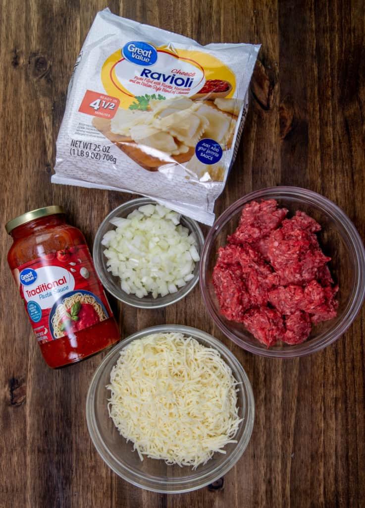 ground beef, yellow onion, jar pasta sauce, frozen cheese ravioli, shredded mozzarella cheese