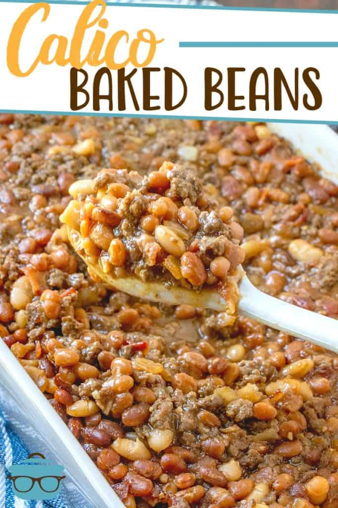 The Best Calico Baked Beans recipe from The Country Cook, pictured in a large white baking dish with a scoop being removed with a white spoon
