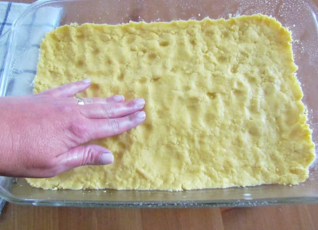 lemon cake mix spread into glass baking dish