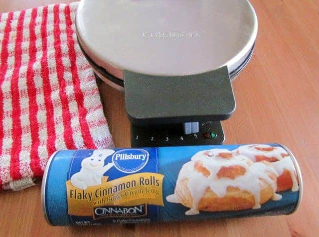 tube of cinnamon rolls with a Cuisinart waffle maker