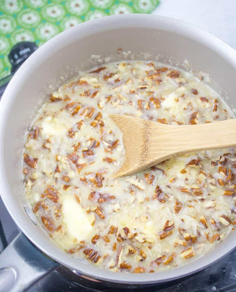 evaporated milk, unsalted butter, chopped pecans, sweetened flaked coconut