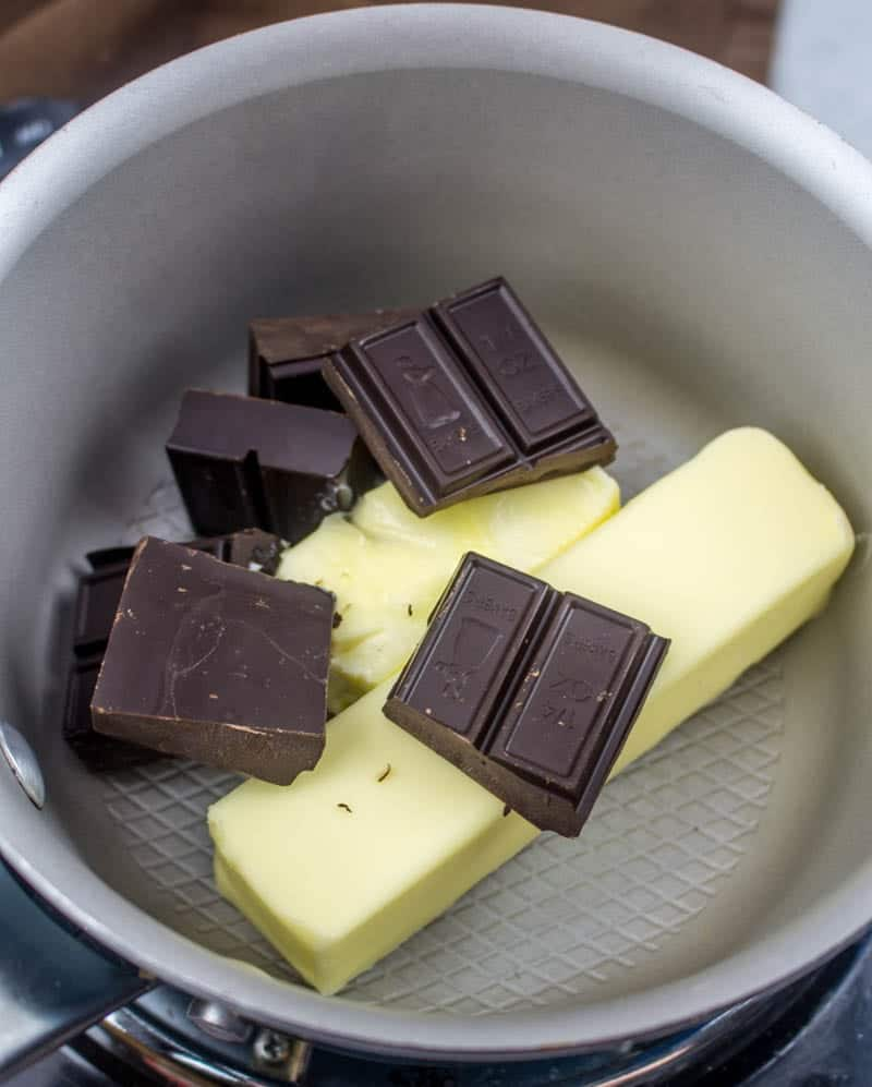 butter and unsweetened chocolate squares in a saucepan