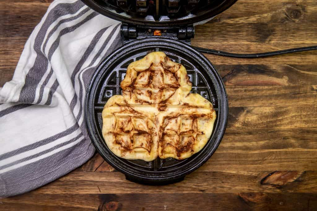 pressed and baked cinnamon rolls inside a waffle maker