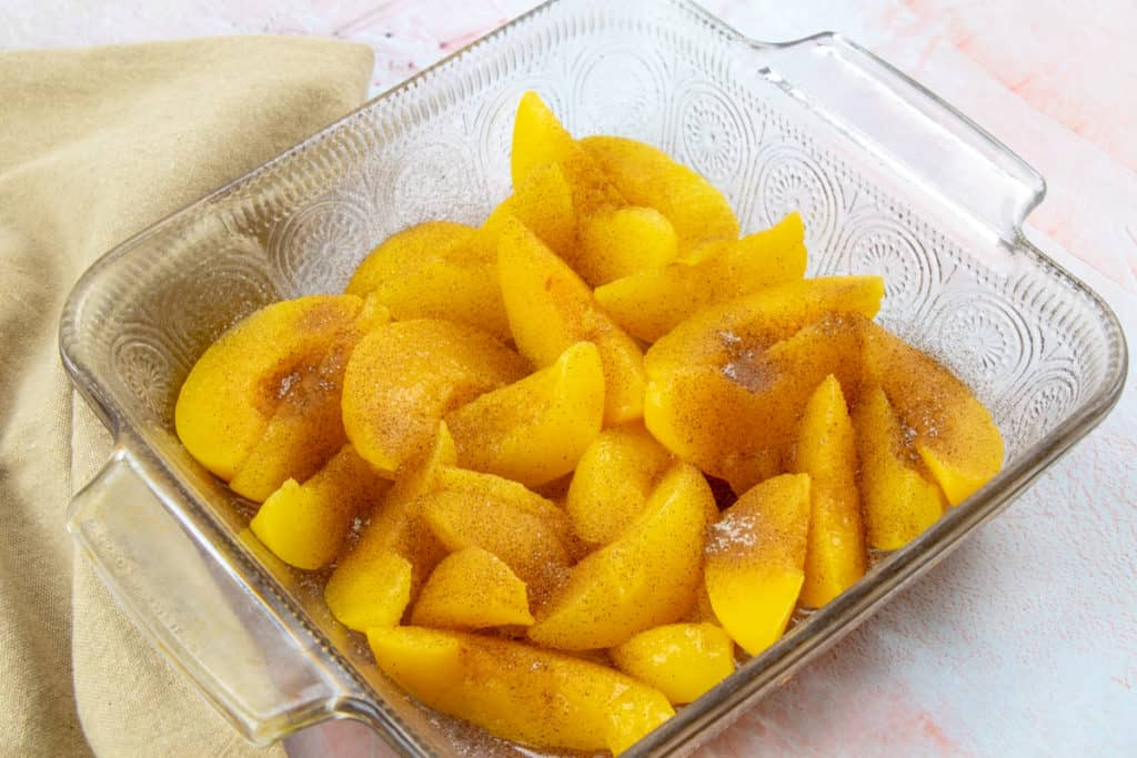 canned peaches sprinkled with cinnamon sugar