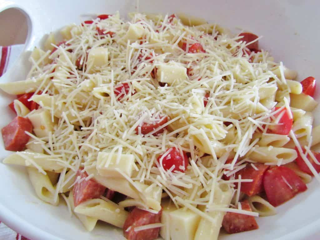 Parmesan cheese added to pepperoni pizza pasta salad