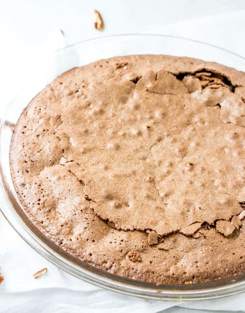 fully baked fudge pie in a glass pie dish
