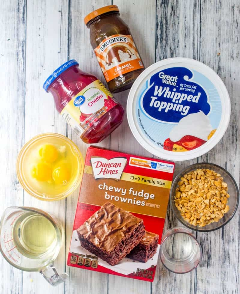 fudge brownie mix, whipped topping, caramel topping, eggs, chopped peanuts, oil, maraschino cherries,