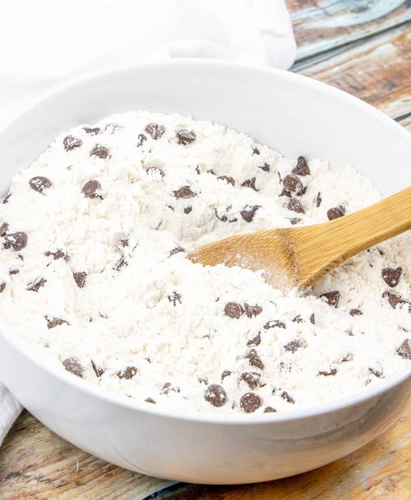 milk chocolate chips added to all purpose flour, sugar, baking powder and salt in a bowl