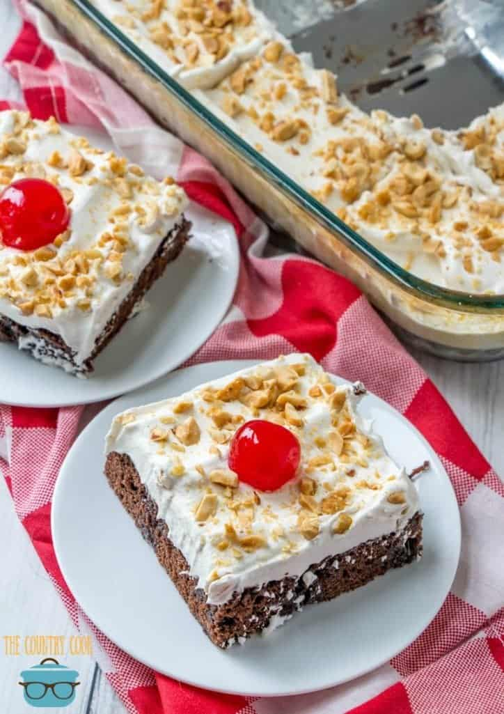 Easy Caramel Brownie Cake slices with cherry on top