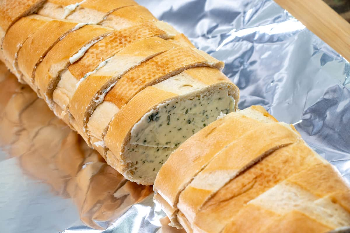 garlic butter spread onto slices of French Bread