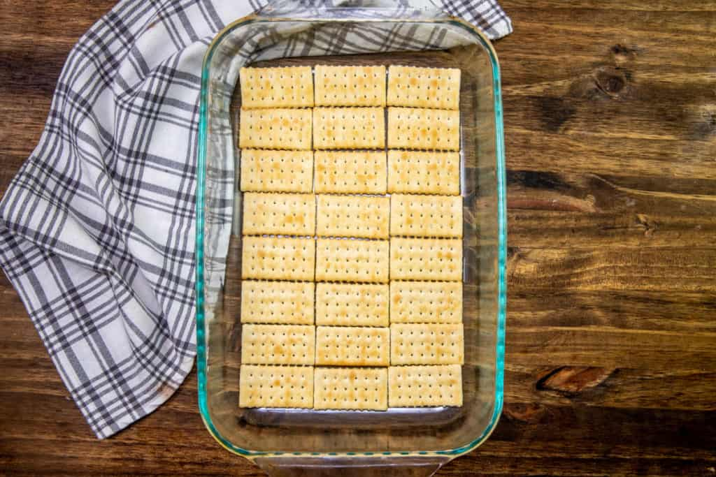 club crackers in a single layer on the bottom of a clear baking dish