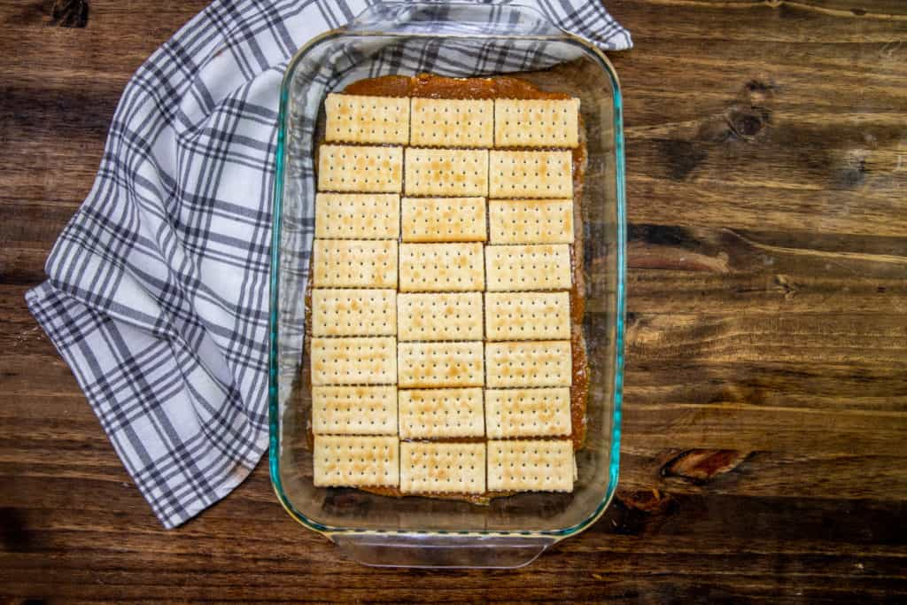 second layer of club crackers on top of graham cracker butter mixture in baking dish